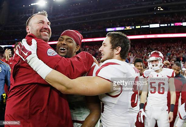 Head coach Bret Bielema of the Arkansas Razorbacks celebrates with his players after the Razorbacks defeated the Texas Longhorns 317 at the AdvoCare...