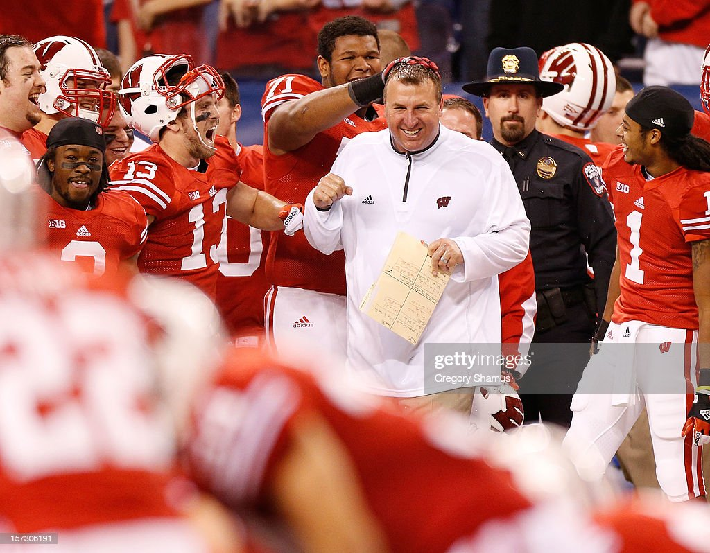 Head coach <a gi-track='captionPersonalityLinkClicked' href=/galleries/search?phrase=Bret+Bielema&family=editorial&specificpeople=818586 ng-click='$event.stopPropagation()'>Bret Bielema</a> smiles on the sideline after being doused with Gatorade during the Big 10 Conference Championship Game at Lucas Oil Stadium on December 1, 2012 in Indianapolis, Indiana. Wisconsin won the game 70-31.