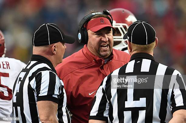 Head coach Brett Bielema of the Arkansas Razorbacks speaks with officials during the first half of a game against the Mississippi Rebels at...