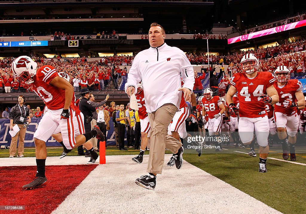 Head coach Brett Bielema of the Wisconsin Badgers leads his team onto the field to play the Nebraska Cornhuskers in the Big 10 Conference Championship Game at Lucas Oil Stadium on December 1, 2012 in Indianapolis, Indiana.