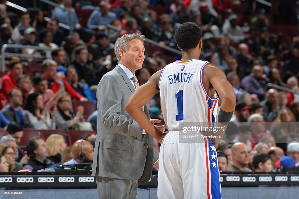 Head Coach <a gi-track='captionPersonalityLinkClicked' href=/galleries/search?phrase=Brett+Brown&family=editorial&specificpeople=2119406 ng-click='$event.stopPropagation()'>Brett Brown</a> of the Philadelphia 76ers smiles with Ish Smith #1 against the Los Angeles Clippers at Wells Fargo Center on February 8, 2016 in Philadelphia, Pennsylvania