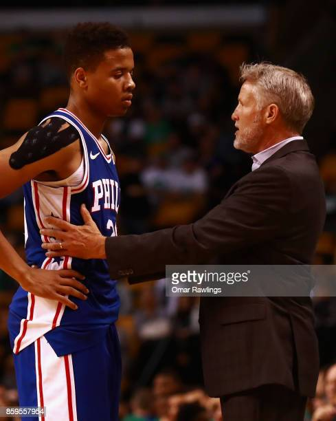 Head Coach Brett Brown talks with Markelle Fultz of the Philadelphia 76ers during the game against the Boston Celtics at TD Garden on October 9 2017...