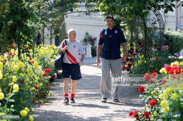 Head coach Brian Ashton and captain Martin Corry take a walk through the gardens at the team hotel in Versaille France