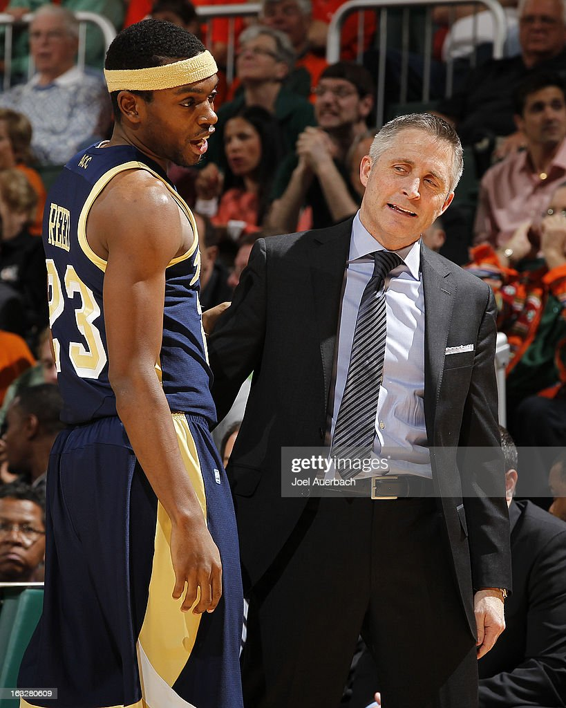 Head coach Brian Gregory talks to Brandon Reed #23 of the Georgia Tech Yellow Jackets late in second half action against the Miami Hurricanes on March 6, 2013 at the BankUnited Center in Coral Gables, Florida. Georgi Tech defeated Miami 71-69.