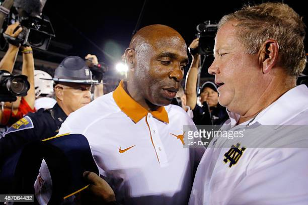 Head coach Brian Kelly of the Notre Dame Fighting Irish and head coach Charlie Strong of the Texas Longhorns shake hands after their game at Notre...