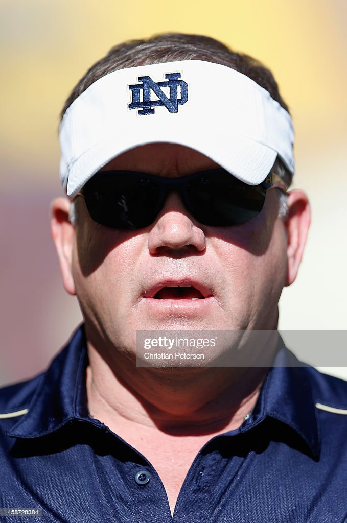 Head coach <a gi-track='captionPersonalityLinkClicked' href=/galleries/search?phrase=Brian+Kelly+-+American+Football+Coach&family=editorial&specificpeople=11611987 ng-click='$event.stopPropagation()'>Brian Kelly</a> of the Notre Dame Fighting Irish before the college football game against the Arizona State Sun Devils at Sun Devil Stadium on November 8, 2014 in Tempe, Arizona. The Sun Devils defeated the Fighting Irish 55-31.