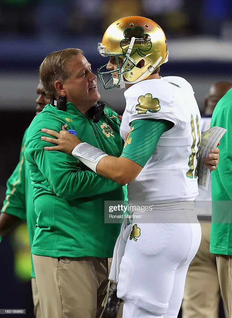 Head coach Brian Kelly of the Notre Dame Fighting Irish celebrates a touchdown with Tommy Rees #11 against the Arizona State Sun Devils at Cowboys Stadium on October 5, 2013 in Arlington, Texas.