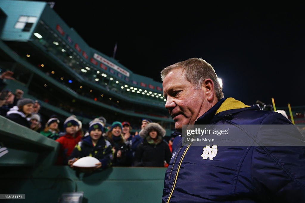 Head coach <a gi-track='captionPersonalityLinkClicked' href=/galleries/search?phrase=Brian+Kelly+-+American+Football+Coach&family=editorial&specificpeople=11611987 ng-click='$event.stopPropagation()'>Brian Kelly</a> of the Notre Dame Fighting Irish exits the field after the game against the Boston College Eagles at Fenway Park on November 21, 2015 in Boston, Massachusetts. The Fighting Irish defeat the Eagles 19-16.