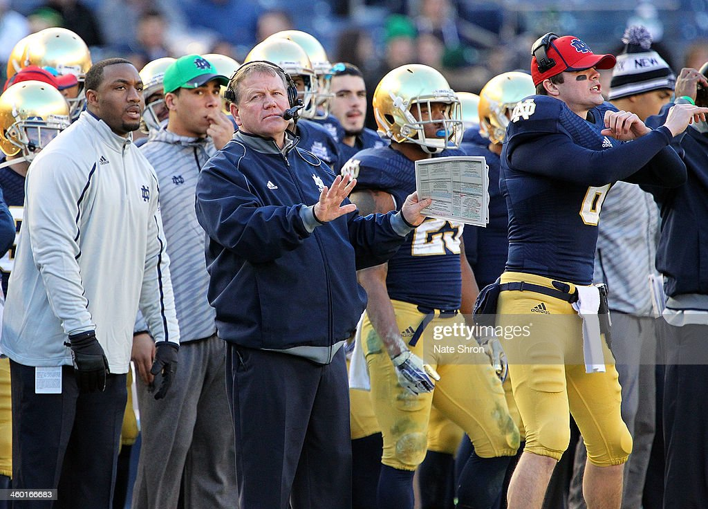 Head coach Brian Kelly of the Notre Dame Fighting Irish gestures from the sideline during the game against the Rutgers Scarlet Knights during the New Era Pinstripe Bowl at Yankee Stadium on December 28, 2013 in the Bronx Borough of New York City.