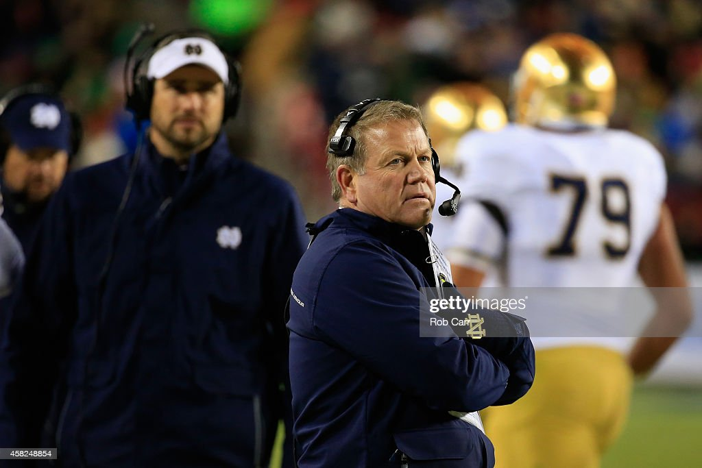 Head coach <a gi-track='captionPersonalityLinkClicked' href=/galleries/search?phrase=Brian+Kelly+-+American+Football+Coach&family=editorial&specificpeople=11611987 ng-click='$event.stopPropagation()'>Brian Kelly</a> of the Notre Dame Fighting Irish looks on from the sidelines during the first half against the Navy Midshipmen at FedExField on November 1, 2014 in Landover, Maryland.