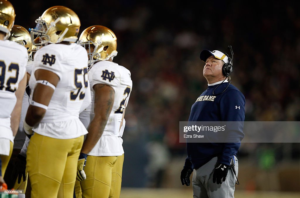 Head coach <a gi-track='captionPersonalityLinkClicked' href=/galleries/search?phrase=Brian+Kelly+-+American+Football+Coach&family=editorial&specificpeople=11611987 ng-click='$event.stopPropagation()'>Brian Kelly</a> of the Notre Dame Fighting Irish stands on the sidelines during their game against the Stanford Cardinal at Stanford Stadium on November 28, 2015 in Palo Alto, California.