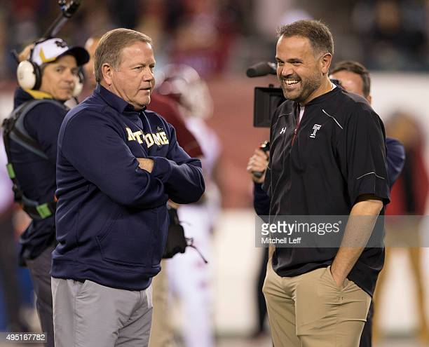 Head coach Brian Kelly of the Notre Dame Fighting Irish talks to head coach Matt Rhule of the Temple Owls prior to the game on October 31 2015 at...