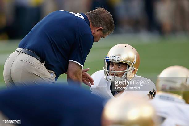 Head coach Brian Kelly of the Notre Dame Fighting Irish talks to quarterback Tommy Rees of the Notre Dame Fighting Irish before the game against the...