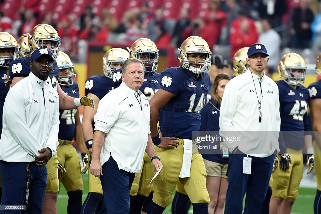 Head coach <a gi-track='captionPersonalityLinkClicked' href=/galleries/search?phrase=Brian+Kelly+-+American+Football+Coach&family=editorial&specificpeople=11611987 ng-click='$event.stopPropagation()'>Brian Kelly</a> of the Notre Dame Fighting Irish walks onto the field before the BattleFrog Fiesta Bowl against the Ohio State Buckeyes at the University of Phoenix Stadium on January 1, 2016 in Glendale, Arizona.