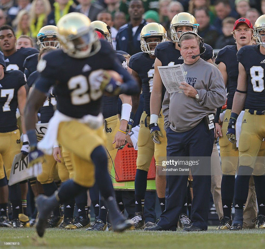 Head coach Brian Kelly of the Notre Dame Fighting Irish watches as Cierre Wood #20 runs against the Wake Forest Demon Deacons at Notre Dame Stadium on November 17, 2012 in South Bend, Indiana. Notre Dame defeated Wake Forest 38-0.