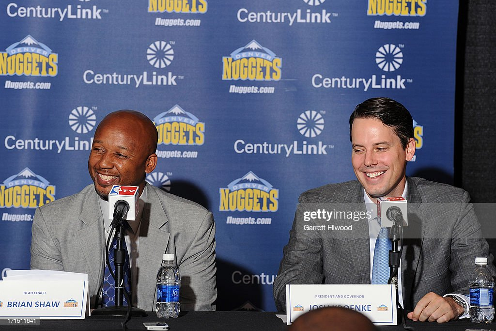 Head Coach Brian Shaw and President <a gi-track='captionPersonalityLinkClicked' href=/galleries/search?phrase=Josh+Kroenke&family=editorial&specificpeople=3079825 ng-click='$event.stopPropagation()'>Josh Kroenke</a> of the Denver Nuggets share a laugh during the press conference on June 25, 2013 at the Pepsi Center in Denver, Colorado.