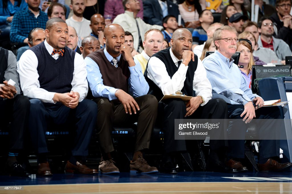 Head Coach Brian Shaw, assistant coaches Melvin Hunt and Lester Conneron, and athetic trainer Jim Gillen of the Denver Nuggets sit on the sideline during a game against the Golden State Warriors April 16, 2014 at the Pepsi Center in Denver, Colorado.
