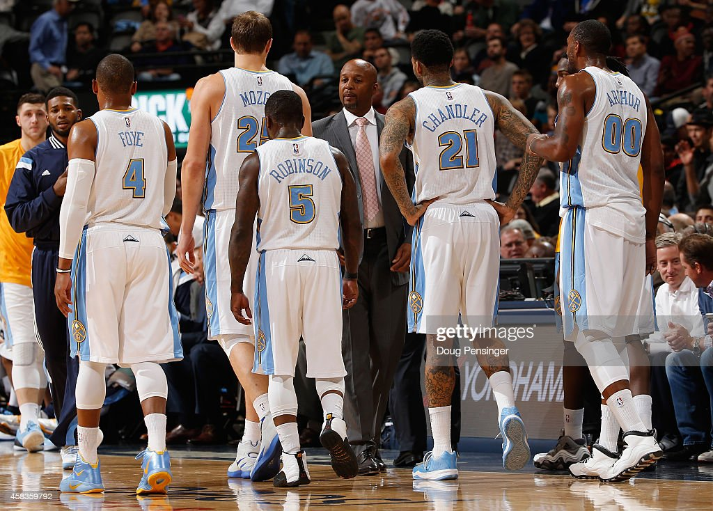 Head coach <a gi-track='captionPersonalityLinkClicked' href=/galleries/search?phrase=Brian+Shaw+-+Basketball+Coach&family=editorial&specificpeople=11376247 ng-click='$event.stopPropagation()'>Brian Shaw</a> (center) of the Denver Nuggets brings <a gi-track='captionPersonalityLinkClicked' href=/galleries/search?phrase=Randy+Foye&family=editorial&specificpeople=240185 ng-click='$event.stopPropagation()'>Randy Foye</a> #4, <a gi-track='captionPersonalityLinkClicked' href=/galleries/search?phrase=Timofey+Mozgov&family=editorial&specificpeople=3949705 ng-click='$event.stopPropagation()'>Timofey Mozgov</a> #25, <a gi-track='captionPersonalityLinkClicked' href=/galleries/search?phrase=Nate+Robinson&family=editorial&specificpeople=208906 ng-click='$event.stopPropagation()'>Nate Robinson</a> #5, <a gi-track='captionPersonalityLinkClicked' href=/galleries/search?phrase=Wilson+Chandler&family=editorial&specificpeople=809324 ng-click='$event.stopPropagation()'>Wilson Chandler</a> #21 and <a gi-track='captionPersonalityLinkClicked' href=/galleries/search?phrase=Darrell+Arthur&family=editorial&specificpeople=4102032 ng-click='$event.stopPropagation()'>Darrell Arthur</a> #00 of the Denver Nuggets to the bench for a time out against the Sacramento Kings at Pepsi Center on November 3, 2014 in Denver, Colorado. The Kings defeated the Nuggets 110-105.