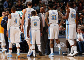 Head coach Brian Shaw of the Denver Nuggets brings Randy Foye Timofey Mozgov Nate Robinson Wilson Chandler and Darrell Arthur of the Denver Nuggets...