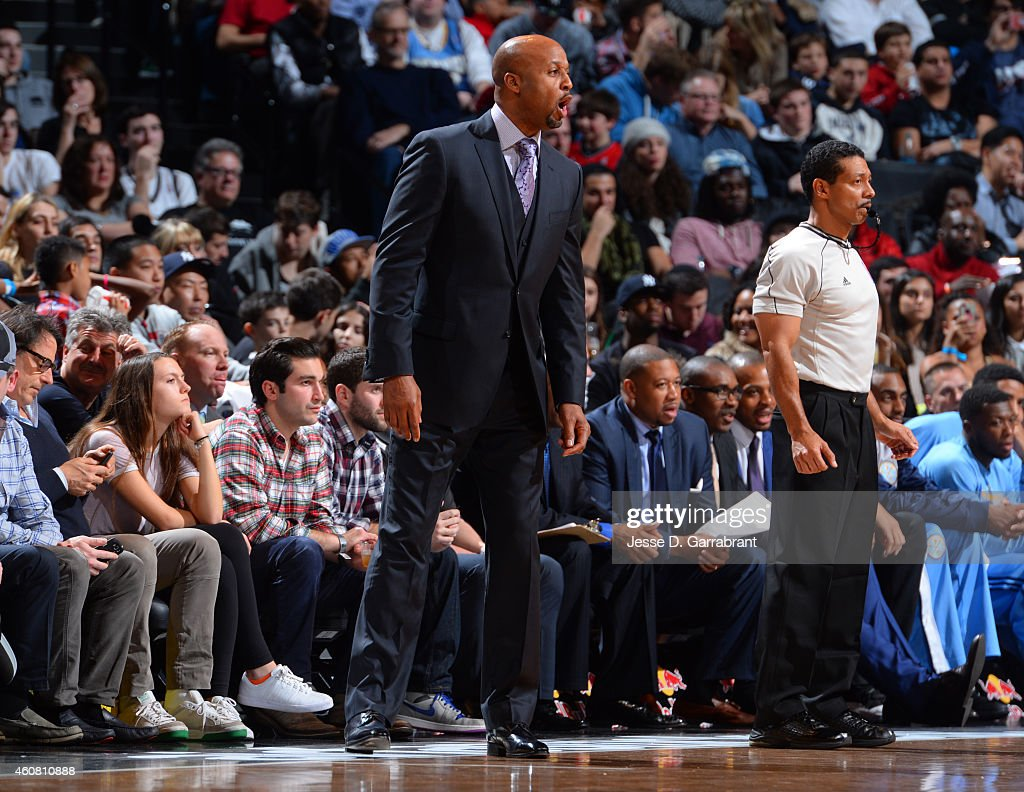 Head Coach <a gi-track='captionPersonalityLinkClicked' href=/galleries/search?phrase=Brian+Shaw+-+Basketball+Coach&family=editorial&specificpeople=11376247 ng-click='$event.stopPropagation()'>Brian Shaw</a> of the Denver Nuggets directs his team against the Brooklyn Nets on December 23, 2014 at the Barclays Center in Brooklyn, NY.
