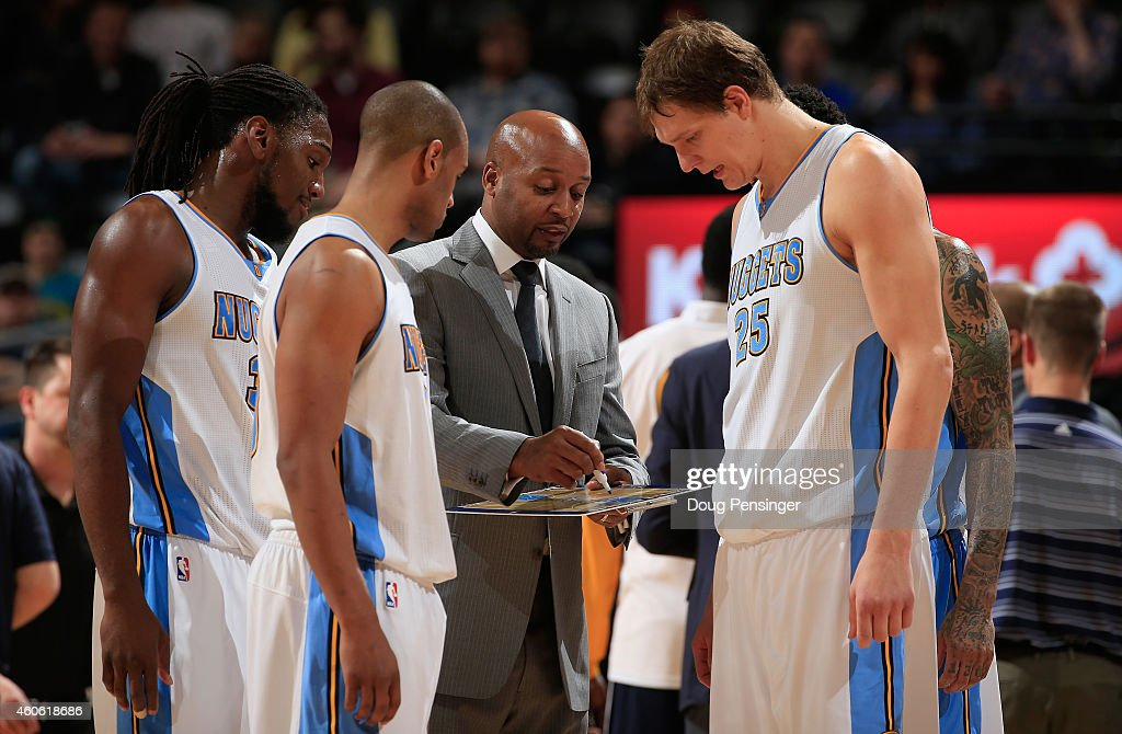 Head coach <a gi-track='captionPersonalityLinkClicked' href=/galleries/search?phrase=Brian+Shaw+-+Basketball+Coach&family=editorial&specificpeople=11376247 ng-click='$event.stopPropagation()'>Brian Shaw</a> of the Denver Nuggets directs <a gi-track='captionPersonalityLinkClicked' href=/galleries/search?phrase=Kenneth+Faried&family=editorial&specificpeople=5765135 ng-click='$event.stopPropagation()'>Kenneth Faried</a> #35, <a gi-track='captionPersonalityLinkClicked' href=/galleries/search?phrase=Arron+Afflalo&family=editorial&specificpeople=640861 ng-click='$event.stopPropagation()'>Arron Afflalo</a> #10 and <a gi-track='captionPersonalityLinkClicked' href=/galleries/search?phrase=Timofey+Mozgov&family=editorial&specificpeople=3949705 ng-click='$event.stopPropagation()'>Timofey Mozgov</a> #25 of the Denver Nuggets during a timeout against the Houston Rockets at Pepsi Center on December 17, 2014 in Denver, Colorado. The Rockets defeated the Nuggets 115-111 in overtime.