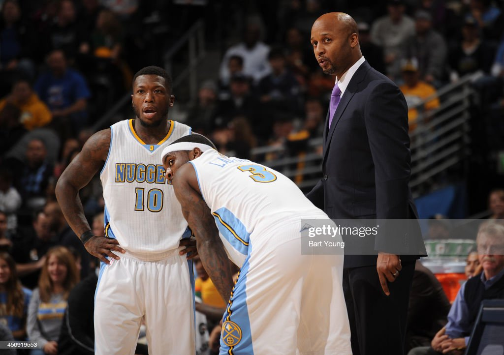 Head Coach Brian Shaw of the Denver Nuggets gives direction to his team against the New Orleans Pelicans on December 15, 2013 at the Pepsi Center in Denver, Colorado.