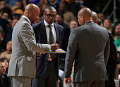 Head coach Brian Shaw of the Denver Nuggets runs a timeout with assistant coaches Patrick Mutombo Melvin Hunt and Lester Conner against the Houston...