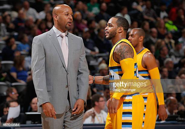 Head coach Brian Shaw of the Denver Nuggets talks to Jameer Nelson of the Denver Nuggets during a timeout against the Boston Celtics at Pepsi Center...