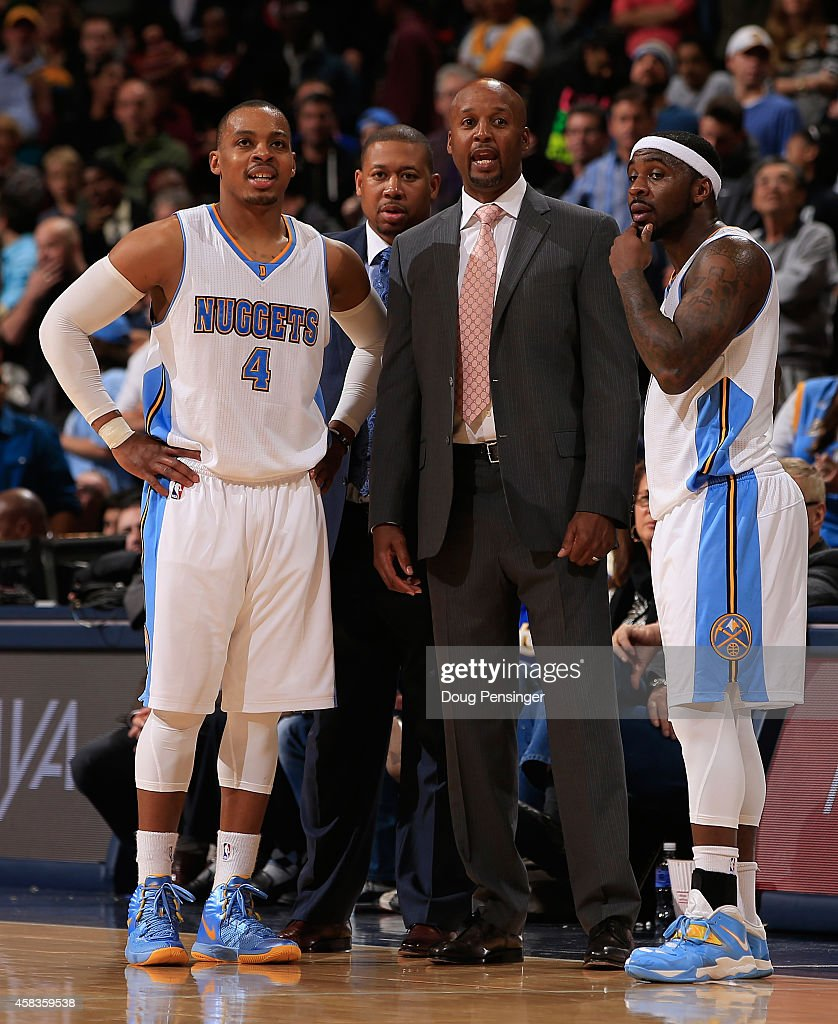Head coach Brian Shaw of the Denver Nuggets talks to Randy Foye and Ty Lawson of the Denver Nuggets during a time out against the Sacramento Kings at...