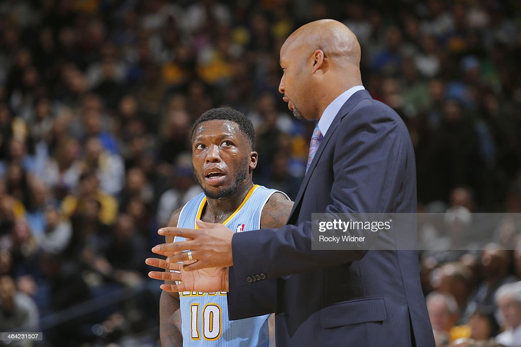 Head Coach Brian Shaw talks to his player Nate Robinson #10 of the Denver Nuggets during a game against the Golden State Warriors on January 15, 2014 at Oracle Arena in Oakland, California.