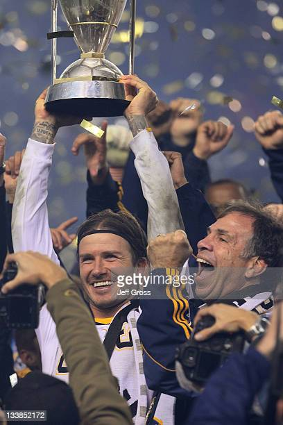 Head coach Bruce Arena and David Beckham of the Los Angeles Galaxy celebrate with the Philip F Anschutz Trophy after defeating the Houston Dynamo 10...