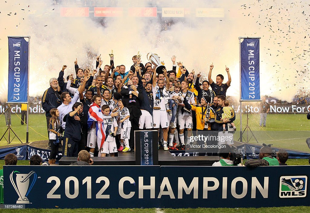 Head coach Bruce Arena and Landon Donovan #10 of Los Angeles Galaxy celebrate the 3-1 victory against the Houston Dynamo to win the 2012 MLS Cup at The Home Depot Center on December 1, 2012 in Carson, California.