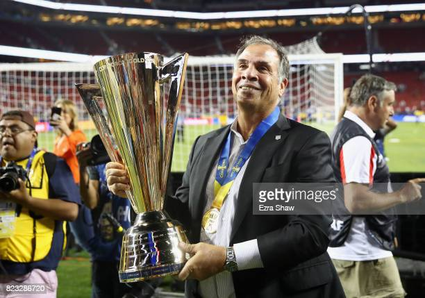 Head coach Bruce Arena holds the trophy after the United States beat Jamaica in the 2017 CONCACAF Gold Cup Final at Levi's Stadium on July 26 2017 in...
