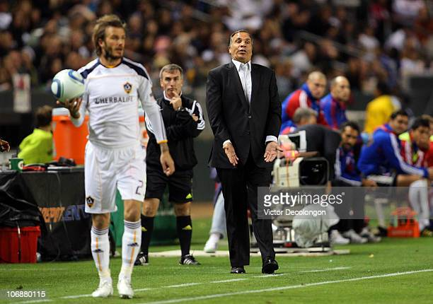 Head Coach Bruce Arena of the Los Angeles Galaxy gestures to one of his players on the field as David Beckham of the Los Angeles Galaxy looks to...
