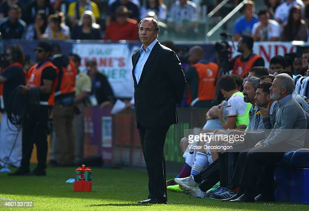 Head Coach Bruce Arena of the Los Angeles Galaxy looks on from the bench area during their 2014 MLS Cup match against the New England Revolution at...