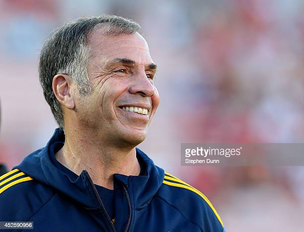 Head coach Bruce Arena of the Los Angeles Galaxy smiles before the match with Manchester United at the Rose Bowl on July 23 2014 in Pasadena...