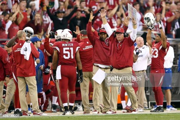 Head coach Bruce Arians celebrates Andre Roberts of the Arizona Cardinals scoring a 34 yard touchdown pass from Carson Palmer in the fourth quarter...