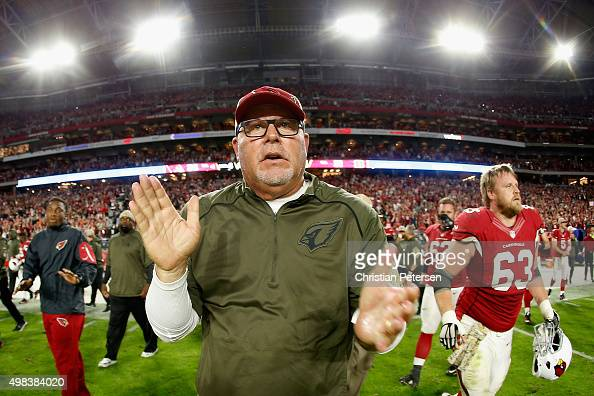 Head coach Bruce Arians of the Arizona Cardinals cheers as he walks out onto the field after defeating the Cincinnati Bengals 3431 in the NFL game at...