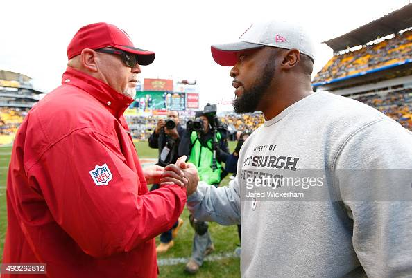 Head Coach Bruce Arians of the Arizona Cardinals greets Head Coach Mike Tomlin of the Pittsburgh Steelers after the game at Heinz Field on October 18...