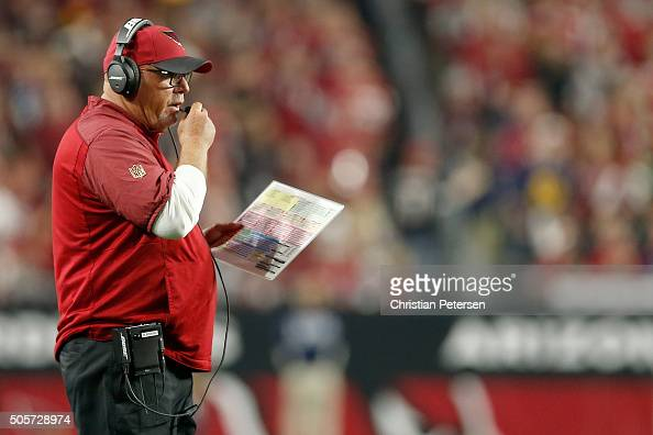Head coach Bruce Arians of the Arizona Cardinals looks on in the second half against the Green Bay Packers in the NFC Divisional Playoff Game at...