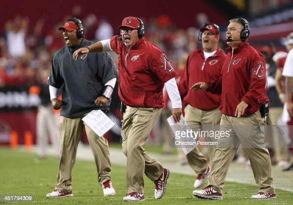 Head coach Bruce Arians of the Arizona Cardinals reacts during the NFL game against the Indianapolis Colts at the University of Phoenix Stadium on...