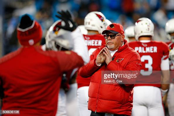 Head coach Bruce Arians of the Arizona Cardinals stands on the field prior to the NFC Championship Game between the Carolina Panthers and the Arizona...