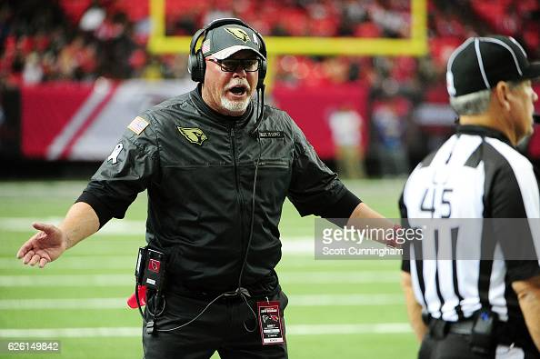 Head coach Bruce Arians of the Arizona Cardinals talks than official during the second half against the Atlanta Falcons at the Georgia Dome on...