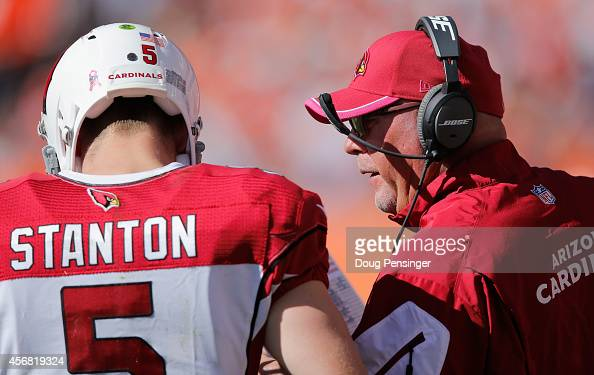 Head coach Bruce Arians of the Arizona Cardinals talks to quarterback Drew Stanton of the Arizona Cardinals as they face the Denver Broncos at Sports...