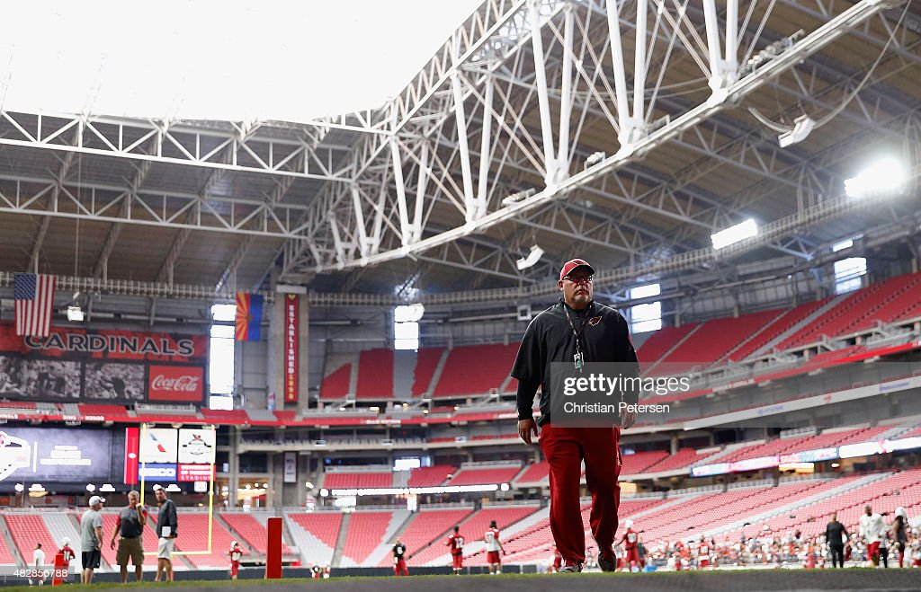 Head coach Bruce Arians of the Arizona Cardinals walks off the field following the team training camp at University of Phoenix Stadium on August 2, 2015 in Glendale, Arizona.
