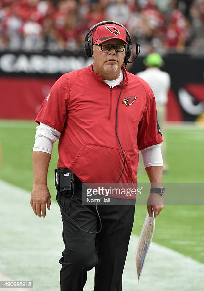 Head coach Bruce Arians of the Arizona Cardinals walks up the sidelines during the game against the San Francisco 49ers at University of Phoenix...