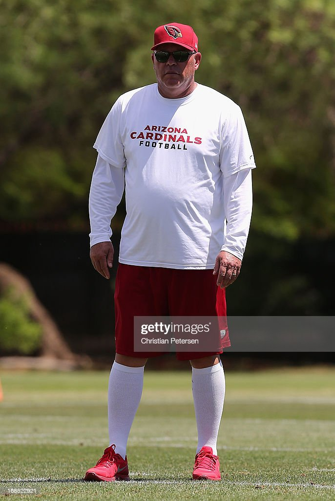 Head coach Bruce Arians of the Arizona Cardinals watches Rookie Camp practice at the team's training center facility on May 10, 2013 in Tempe, Arizona.