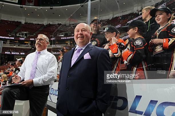Head coach Bruce Boudreau and assistant coach Paul MacLean of the Anaheim Ducks show their support for Hockey Fights Cancer by wearing lavender...