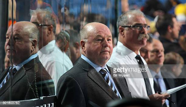 Head coach Bruce Boudreau and assistant coach Paul MacLean of the Anaheim Ducks watch warmups before an NHL game against the Buffalo Sabres on...