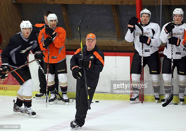 Head Coach Bruce Boudreau of the Anaheim Ducks directs his team through practice at Anaheim Ice on December 1 2011 in Anaheim California